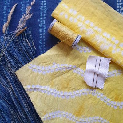 Stitched resist dye